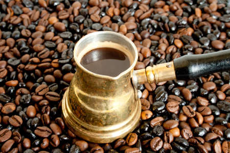 coffeebeans: Arab small coffee pot on coffee-beans background