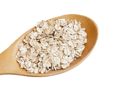 whitw: Dry rolled oats seed in wooden spoon over whitw background