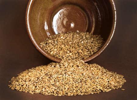 Flax seed on ceramic bowl on broun background Stock Photo - 16824685