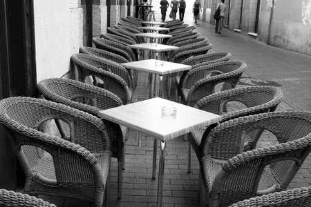 wicker bar: Table and wicker chairs of cafe in the street