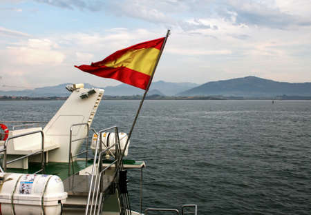 stern: Spanish flag at the stern of cutter in Cantabria sea near of Santander, Spain Stock Photo