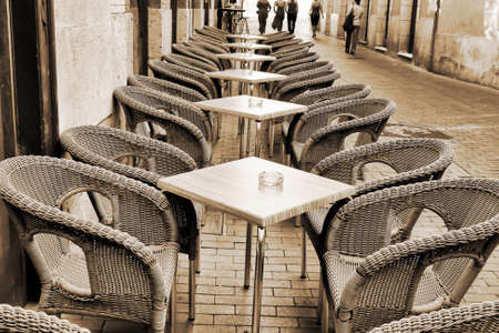 Table and wicker chairs of cafe in Valladolid, Spain