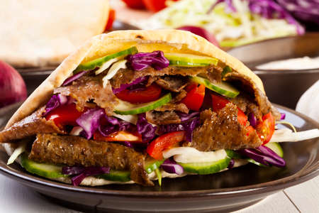 Beef Kebab in a bun on woodboard Stok Fotoğraf - 37819637
