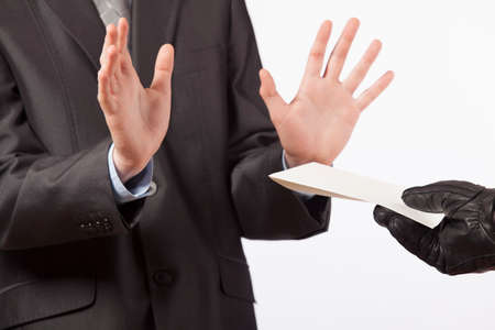 Business concept - a man in a suit does not accept a bribe - white background Stock Photo