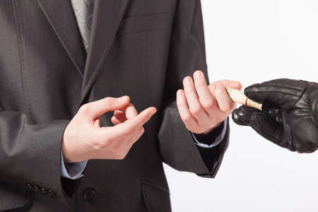 offender: Business concept - a man in a suit takes a bribe from the offender