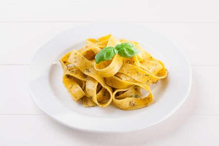 Pasta tagiatelle with pesto on white woodboard Stok Fotoğraf