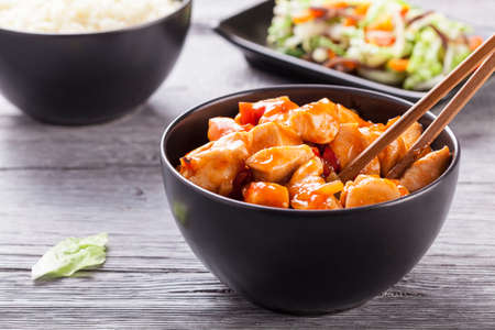 Chinese chicken sweet and sour sauce, served with rice and vegetables on woodboard Stok Fotoğraf - 37876671
