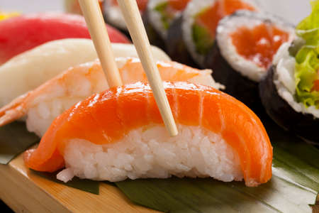 sushi plate: The composition of nigiri sushi with tuna, salmon, shrimp, butterfish on rice Stock Photo