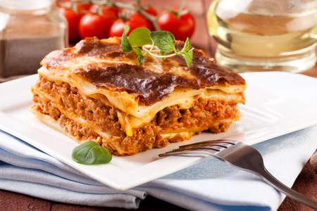 Portion of tasty lasagna on a plate - focus on piece Stok Fotoğraf