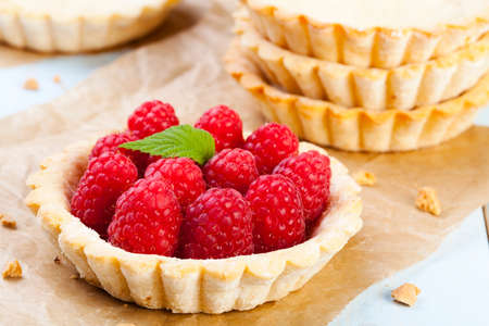 Home made tartlets with raspberries photo