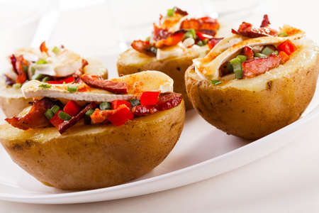 potatoe: Baked potatoes stuffed with bacon and vegetables served with camembert