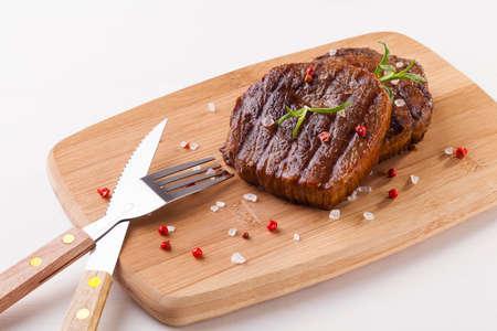 Grilled beef steak on wooden board Stok Fotoğraf - 38203197