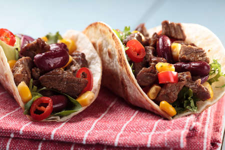 plates of food: Serving taco with beef and vegetables Stock Photo
