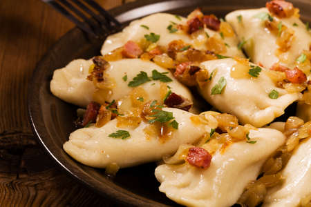 Delicious homemade dumplings with onion and bacon photo