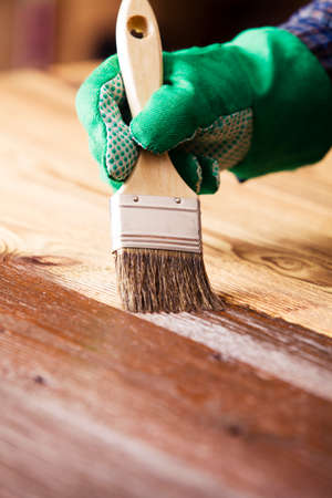 Painting and wood maintenance oil-wax Stock Photo