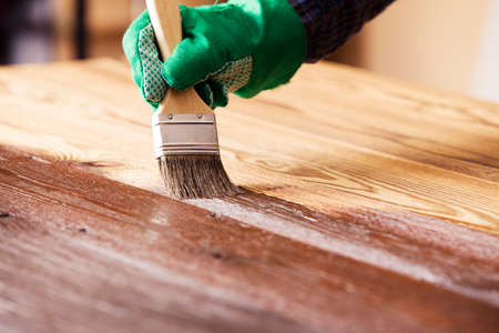 deck: Painting and wood maintenance oil-wax Stock Photo