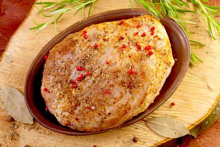 marinade: Raw ham in marinade on wood board