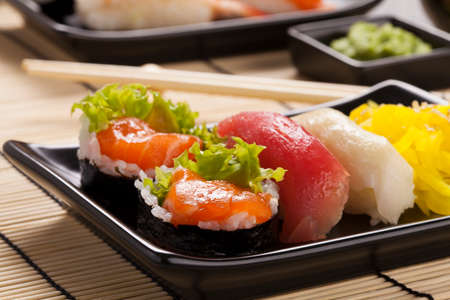 dinner plate: The composition of sushi - hosomaki with salmon, avocado and rice