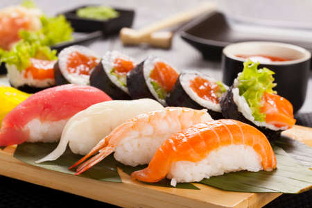 The composition of nigiri sushi with tuna, salmon, shrimp, butterfish on rice Stock Photo