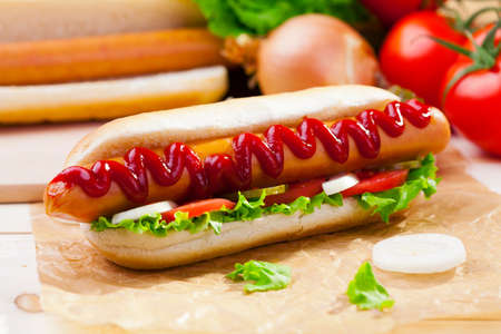 hotdog sandwiches: Hot dogs with mustard, ketchup on a picnic table Stock Photo