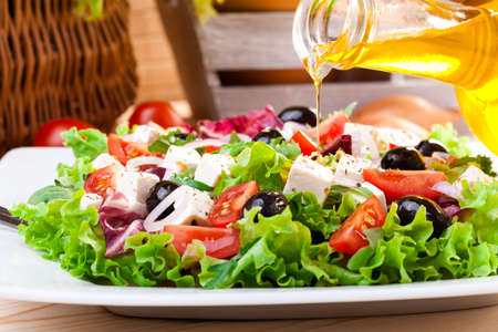 salads: Fresh Greek salad on a plate