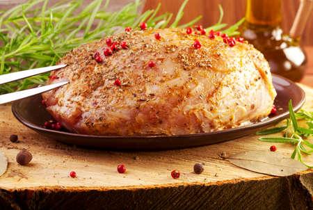 raw ham: Raw ham in marinade on wood board