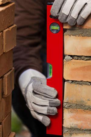 leveling the masonry bricks photo