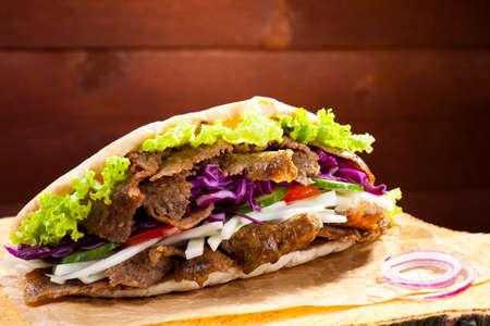 Beef Kebab in a bun on woodboard Banco de Imagens - 41142499