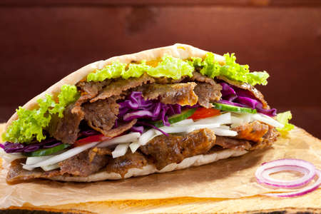 Beef Kebab in a bun on woodboard Фото со стока - 41142509