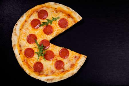 peperoni: Pizza peperoni on stone black try with rocket and mozzarella cheese Stock Photo