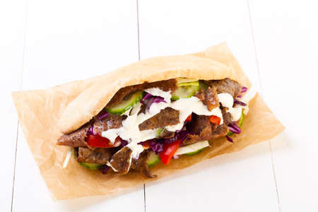 Beef Kebab in a bun on woodboard