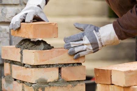 brick work: Bricklaying brick wall Stock Photo