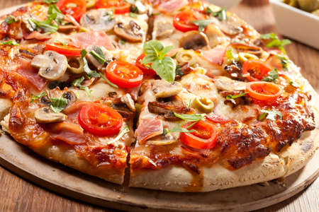 Pizza with ham and mushrooms on plate