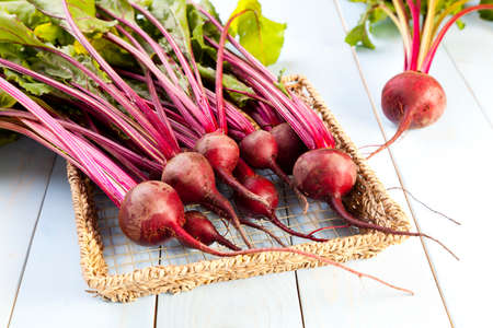 Fresh beets on a wooden board
