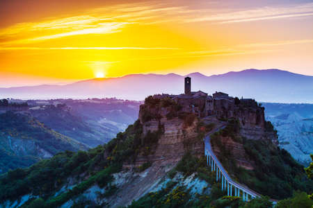 farm landscape: Civita di Bagnoregio, old town on sunrice. Tuscany, Italy Stock Photo