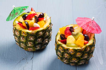 mixed fruit: Fresh fruit salad served in bowls with fresh pineapple Stock Photo