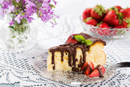drenched: Homemade cheesecake with strawberries drenched in chocolate.