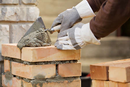 Bricklaying brick wall Stock Photo