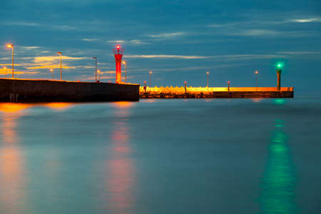Entrance to the port at night in Łeba Poland 版權商用圖片