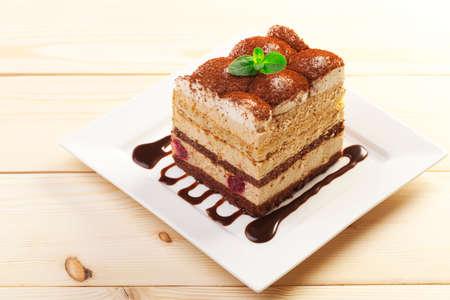cake plate: tiramisu cake on plate Stock Photo