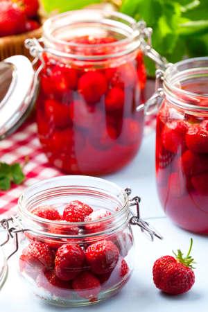 compote: Homemade preserves, prepare compote of strawberries. Stock Photo