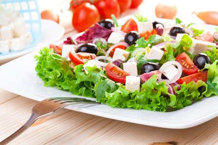 Fresh Greek salad on a plate Stock Photo