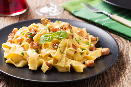 Pasta Carbonara with bacon, basil and cheese