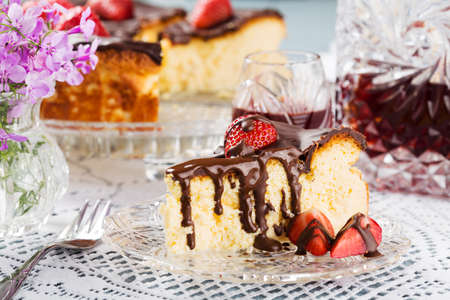 cream cake: Homemade cheesecake with strawberries drenched in chocolate, served with alcohol.