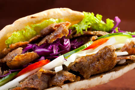 Beef Kebab in a bun on woodboard Stok Fotoğraf - 45677014