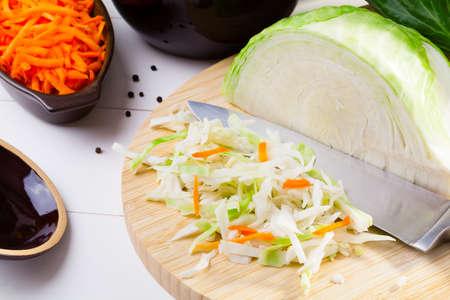brine: Fresh cabbage prepared for pickling on woodboard