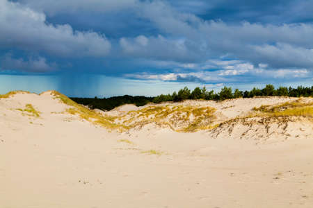 Sand dunes on the Baltic coast in the morning - storm clouds