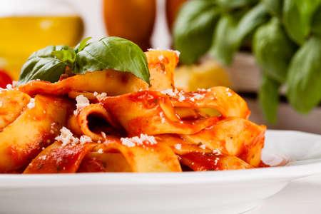 tomato: Pasta tagiatelle with tomato on white woodboard Stock Photo