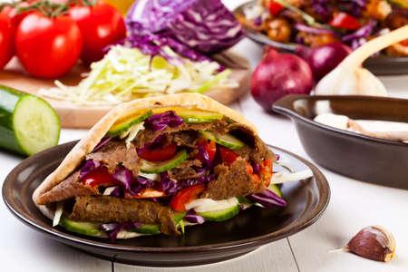 donner: Beef Kebab in a bun on woodboard