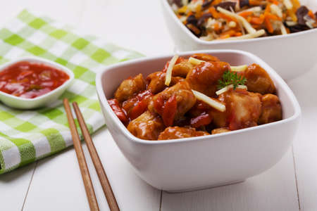 stir: Fried chicken pieces in batter with sweet and sour sauce